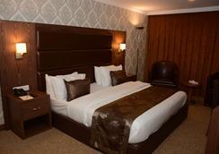 安卡瓦皇家Spa酒店 - 埃爾比勒 - 臥室