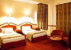 New Ambassador Hotel - Harare - 臥室