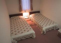 弗洛紐酒店 - 富良野 - 臥室