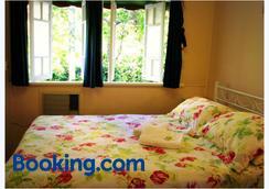 珊瑚山林小屋住宿加早餐旅館 - 湯斯維爾 - 臥室