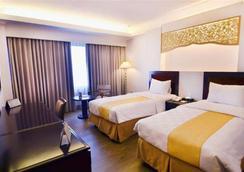 布明米廊基里亞德酒店 - 巴東 - 臥室