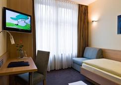 柏麗娜霍夫城市夥伴酒店 - 卡爾斯魯厄 - 臥室