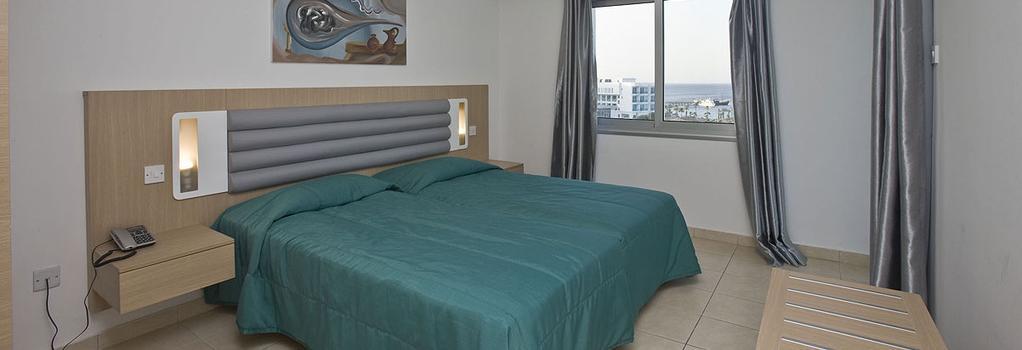 Vrissaki Hotel Apartments - 帕拉利米尼 - 臥室
