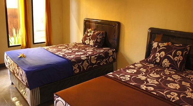 Bidadari Hotel - 庫塔 - 臥室