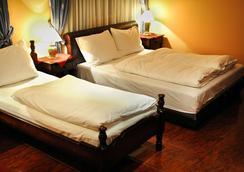 艾芙洛帕酒店 - 波德戈里察 - 臥室