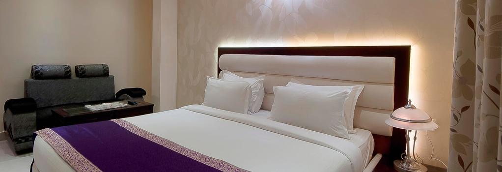 Central Residency Hotel - 瓦拉納西 - 臥室