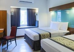 溫德姆麥克特爾UP特克諾豪布酒店 - Quezon City - 臥室