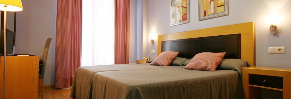 Hotel San Marcos - 巴達霍斯 - 臥室