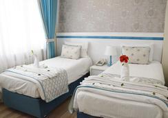 假日之星酒店 - 伊斯坦堡 - 臥室