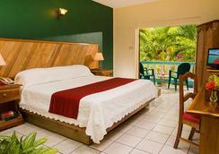 傳奇海灘度假酒店 - 尼格瑞爾 - 臥室