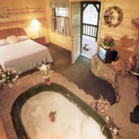 Big Bear Manor Spa Cabins Romantic Jacuzzi tub for 2 by the wood-burning fireplace in each cabin