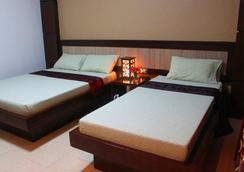 爾訥斯特房長灘島飯店 - Malay - 臥室