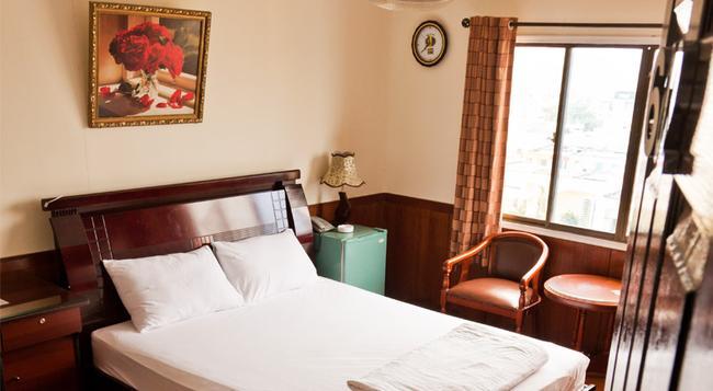 Tan Hoang Mai Hotel - 胡志明市 - 臥室