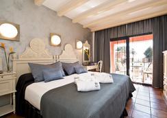 卡拉德爾皮水療酒店 - 薩卡羅 - 臥室