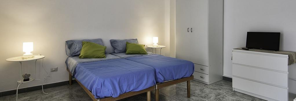 Archita Guest House & Apartment - 巴里 - 臥室