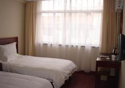 格林豪泰江蘇省南通市通州區汽車站快捷酒店 - 南通 - 臥室