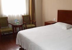 格林豪泰山東省煙台市機場路魯東大學商務酒店 - 煙台 - 臥室