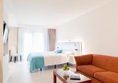 拉特拉薩Spa酒店 - 薩卡羅 - 臥室