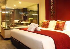 曼谷是隆富麗華飯店 - 曼谷 - 臥室