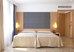 阿瑪答瑪斯酒店 - 帕爾馬 - 臥室