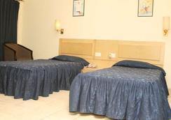 維士瓦拉塔納酒店 - 古瓦哈蒂 - 臥室