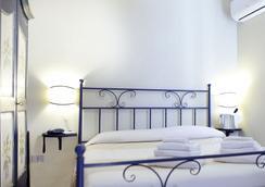 Hotel Domominore - 阿爾蓋羅 - 臥室