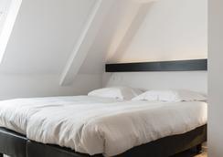 坡提納里酒店 - 布魯日 - 臥室