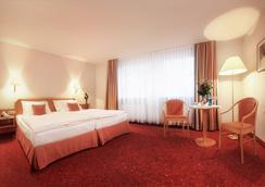 蒂安尼公園酒店 - 萊比錫 - 臥室