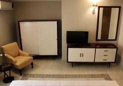 Entre Patios Hotel Boutique - 利昂 - 臥室