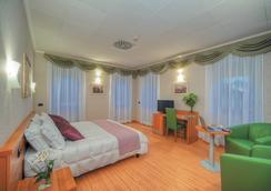 潘菲利格里公園酒店 - 羅馬 - 臥室