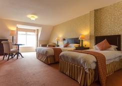 沙屋酒店 - 多尼戈爾 - 臥室