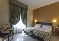 雷吉納吉雅萬納酒店 - 羅馬 - 臥室