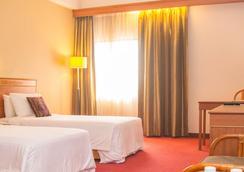 古晉大洲酒店 - 古晉 - 臥室