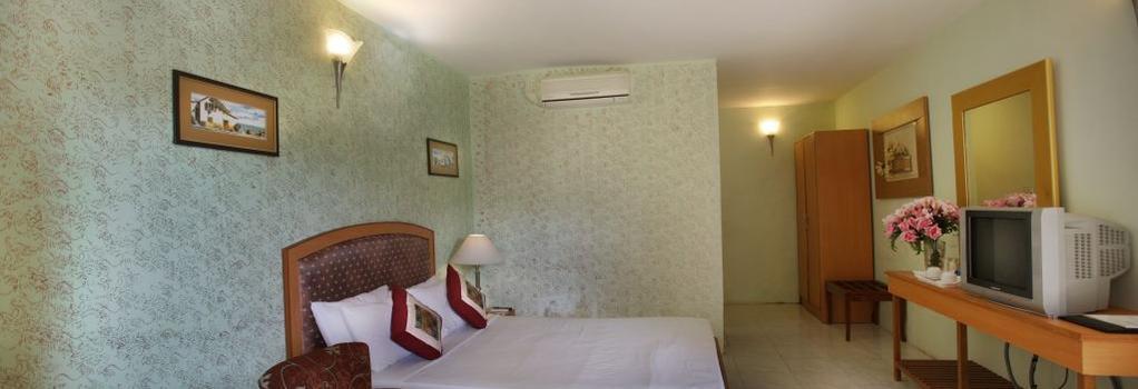 Jayamahal Palace Hotel - 班加羅爾 - 臥室