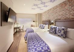 阿提紳DC酒店- 傲途格精選酒店 - Bogotá - 臥室