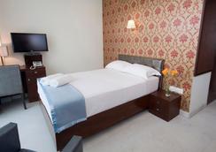 公園之坡住宿加早餐旅館 - 班加羅爾 - 臥室