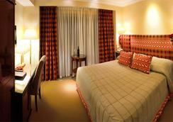 瑞士酒店 - 利沃夫 - 臥室