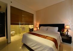 艾米利亞迷人酒店 - 巨港 - 臥室