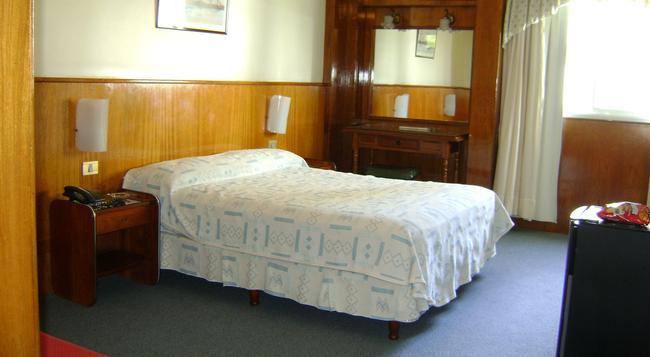 Hotel Alpino - 布宜諾斯艾利斯 - 臥室