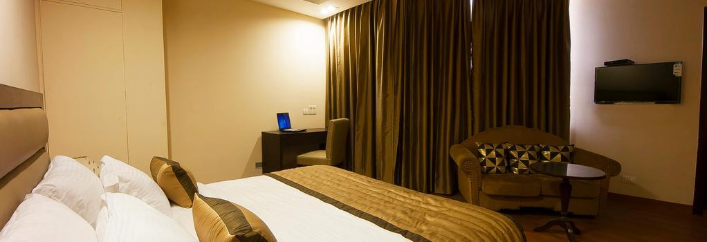 Hotel Aura, Igi Airport - 新德里 - 臥室