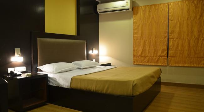 Santhome Inn - 清奈 - 臥室