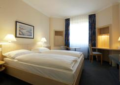 Intercityhotel Kassel - 卡塞爾 - 臥室