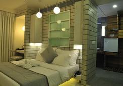 埃爾多拉多酒店 - 艾哈邁達巴德 - 臥室