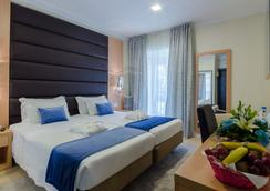 美式羅西奧酒店 - 里斯本 - 臥室