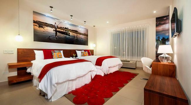 Elements Hotel Boutique - 馬拿瓜 - 臥室
