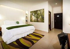 元素精品酒店 - 馬拿瓜 - 臥室