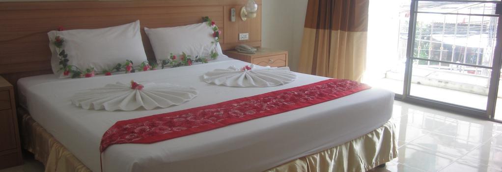 Bella Tropicana Hotel & Guesthouse - 巴東 - 臥室