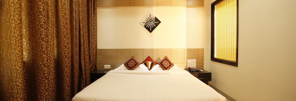 Fabhotel Arafa Inn Gandhinagar - 班加羅爾 - 臥室