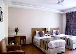 阿爾皮娜酒店&套房 - 新德里 - 臥室