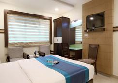Fabhotel Monarch Jayanagar - 班加羅爾 - 臥室